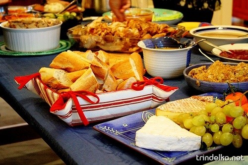 1265276436_table-of-food.jpg